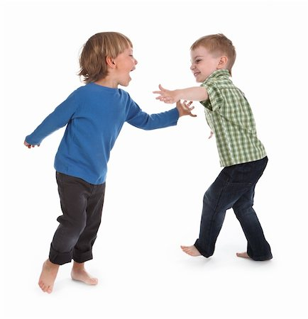 two boys having fun on white background Stock Photo - Budget Royalty-Free & Subscription, Code: 400-05891351