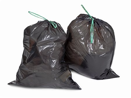 two tied garbage bags on white background Stock Photo - Budget Royalty-Free & Subscription, Code: 400-05891352