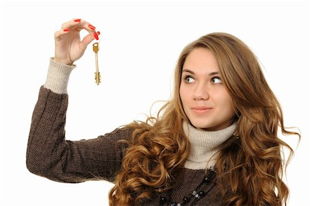 Portrait of charming young woman holding keys isolated over white background Stock Photo - Budget Royalty-Free & Subscription, Code: 400-05892157