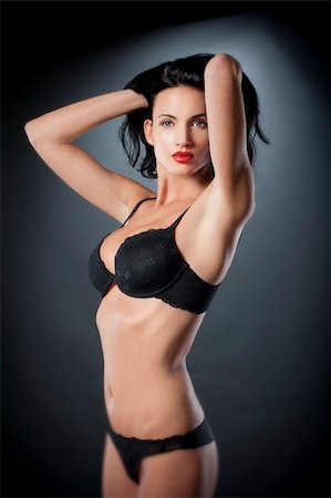beautiful woman with dark hair in sexy black underwear over gray Stock Photo - Budget Royalty-Free & Subscription, Code: 400-05893374