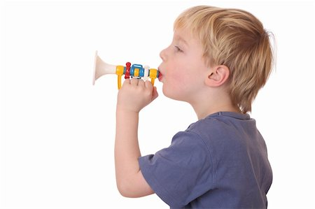 Portrait of a young boy playing a toy trumpet on white background Stock Photo - Budget Royalty-Free & Subscription, Code: 400-05893730