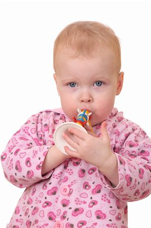 Portrait of a toddler playing a toy trumpet on white background Stock Photo - Budget Royalty-Free & Subscription, Code: 400-05893731