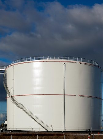 pipework - oil tank with blue sky Stock Photo - Budget Royalty-Free & Subscription, Code: 400-05893822