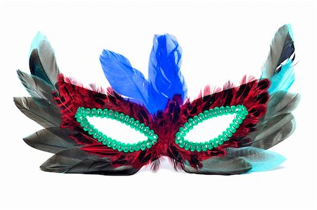 a carnival mask with feathers of different colors on a white background Stock Photo - Budget Royalty-Free & Subscription, Code: 400-05904724