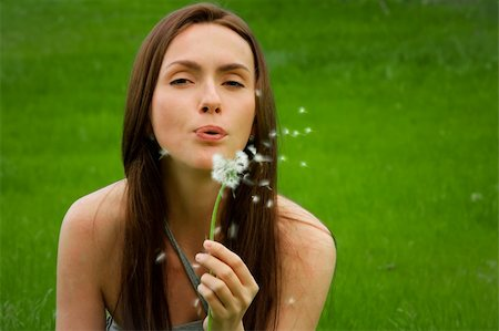 Girl with dandelion on green field Stock Photo - Budget Royalty-Free & Subscription, Code: 400-05905844