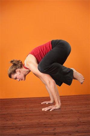 feet gymnast - Caucasian woman in Bakasana crane pose over orange background Stock Photo - Budget Royalty-Free & Subscription, Code: 400-05907909