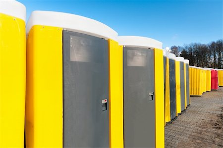 yellow portable toilets under a nice cloudy sky Stock Photo - Budget Royalty-Free & Subscription, Code: 400-05908595