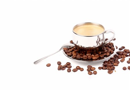 metal Cup of espresso coffee with spoon and seeds on the white background Stock Photo - Budget Royalty-Free & Subscription, Code: 400-05901096