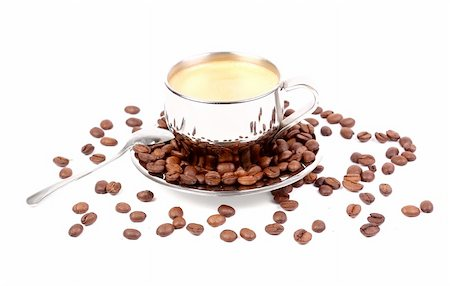 metal Cup of espresso coffee with spoon and seeds on the white background Stock Photo - Budget Royalty-Free & Subscription, Code: 400-05901097