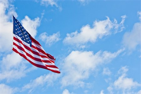 flag at half mast - American flag on a blue sky during a windy day Stock Photo - Budget Royalty-Free & Subscription, Code: 400-05902840