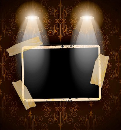 Antique distressed photoframes with old dirty look on a vintage seamless wallpaper. Frames are featured by led spotlights.Shadows are transparent. Stock Photo - Budget Royalty-Free & Subscription, Code: 400-05903130