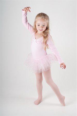 Studio shot of ballet dancer girl in pink Stock Photo - Budget Royalty-Free & Subscription, Code: 400-05916938