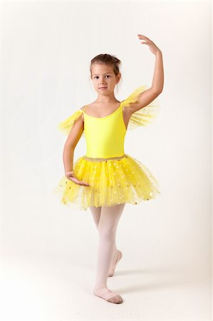 Cute little girl as ballet dancer, studio shot on white background Stock Photo - Budget Royalty-Free & Subscription, Code: 400-05917599