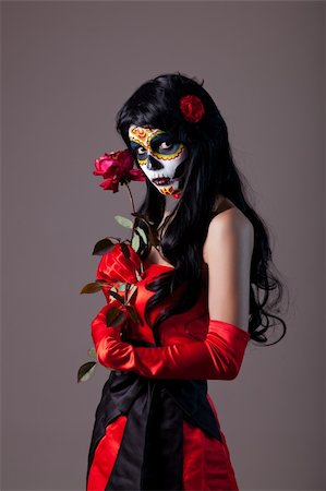 Sugar skull girl with red rose, studio shot Stock Photo - Budget Royalty-Free & Subscription, Code: 400-05917593