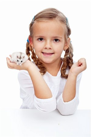 Here is my hamster - little girl with her pet Stock Photo - Budget Royalty-Free & Subscription, Code: 400-05919524