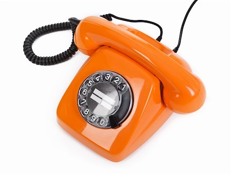 classic dial phone on white background Stock Photo - Budget Royalty-Free & Subscription, Code: 400-05912092