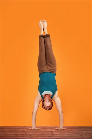 feet gymnast - Woman does Adho Mukha Vriksasana yogasana upside down Stock Photo - Budget Royalty-Free & Subscription, Code: 400-05913567