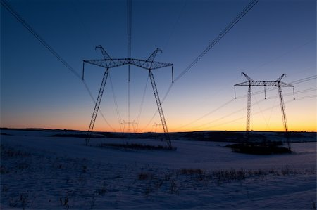 Cold winter daybreak above high voltage powerlines Stock Photo - Budget Royalty-Free & Subscription, Code: 400-05913575