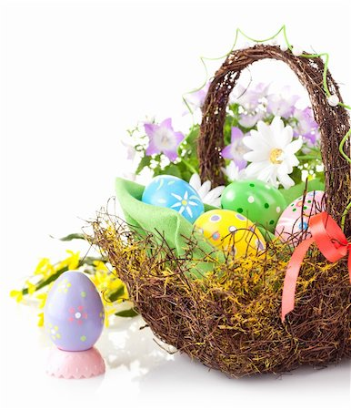 easter egg in basket with spring flower isolated on white background Stock Photo - Budget Royalty-Free & Subscription, Code: 400-05927680