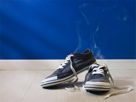 concept shot of feet perspiration: bad smell coming out from old and dirty shoes Stock Photo - Budget Royalty-Free & Subscription, Code: 400-05927737