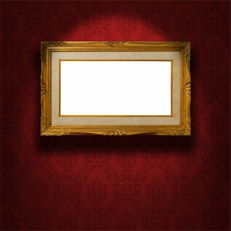 Empty golden frame illuminated from a spotlight. The frame is on the red damask wallpaper. Clipping path included. Stock Photo - Budget Royalty-Free & Subscription, Code: 400-05920880