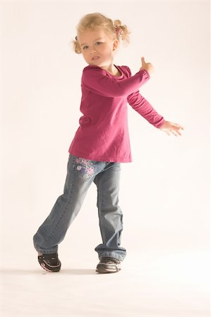 Little blonde girl with curly hair has fun at the dance Stock Photo - Budget Royalty-Free & Subscription, Code: 400-05946485