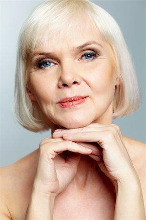 Mature lady looking calmly at camera Stock Photo - Budget Royalty-Free & Subscription, Code: 400-06064675