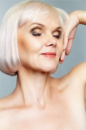 Portrait of a nude mature lady with her eyes closed and hand gracefully held Stock Photo - Budget Royalty-Free & Subscription, Code: 400-06064676