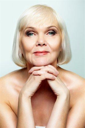 Mature lady looking calmly at camera Stock Photo - Budget Royalty-Free & Subscription, Code: 400-06064677
