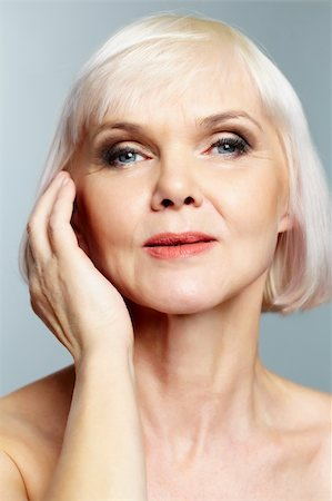 Woman of senior age holding her hand gracefully near face Stock Photo - Budget Royalty-Free & Subscription, Code: 400-06064671