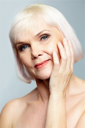 Senior nude woman looking at camera with a charming smile Stock Photo - Budget Royalty-Free & Subscription, Code: 400-06064673