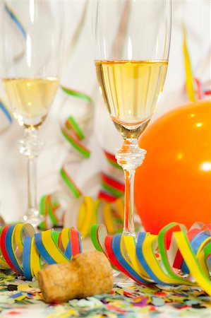 party celebration paper confetti - Two glasses of champagne and confetti and ballons Stock Photo - Budget Royalty-Free & Subscription, Code: 400-06064766