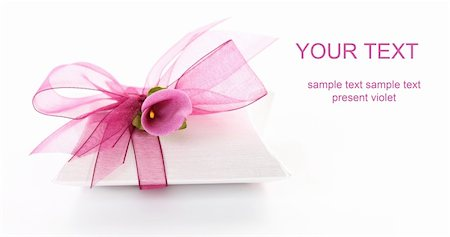 Small gift box decorated with ribbon and flower with copy space for your text Stock Photo - Budget Royalty-Free & Subscription, Code: 400-06066798