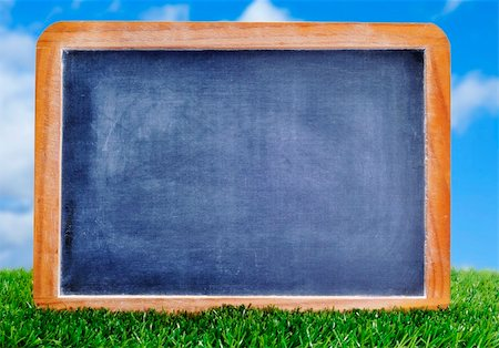 a blank blackboard on the grass to insert such as soccer matches or scores Stock Photo - Budget Royalty-Free & Subscription, Code: 400-06067457