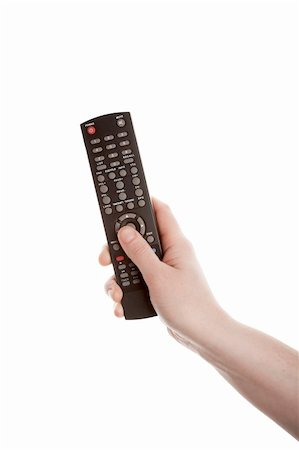 finger holding a key - Television remote control in the hand isolated on white background Stock Photo - Budget Royalty-Free & Subscription, Code: 400-06069945