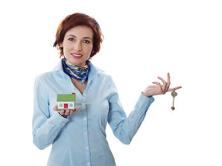 Beautiful young woman holding keys and house model over white - real estate loan concept Stock Photo - Budget Royalty-Free & Subscription, Code: 400-06060051