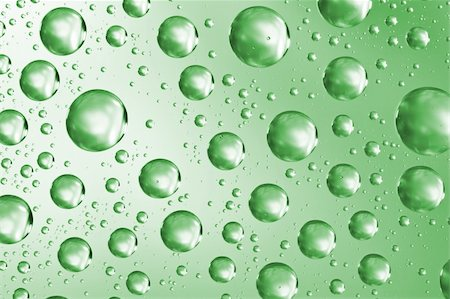 Close up of water drops on green glass surface as background Stock Photo - Budget Royalty-Free & Subscription, Code: 400-06063661