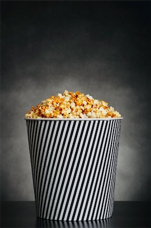 Popcorn in a container on black background Stock Photo - Budget Royalty-Free & Subscription, Code: 400-06063922
