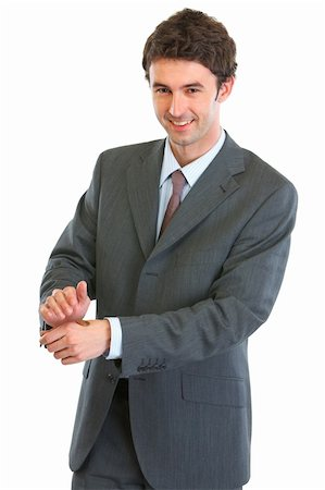 Modern business man showing tossed coin Stock Photo - Budget Royalty-Free & Subscription, Code: 400-06076085