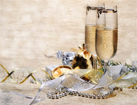 Two champagne glasses with presents and decorative ribbon Stock Photo - Budget Royalty-Free & Subscription, Code: 400-06076963