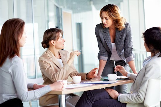 Image of four businesswomen interacting at meeting Stock Photo - Royalty-Free, Artist: pressmaster, Image code: 400-06070539