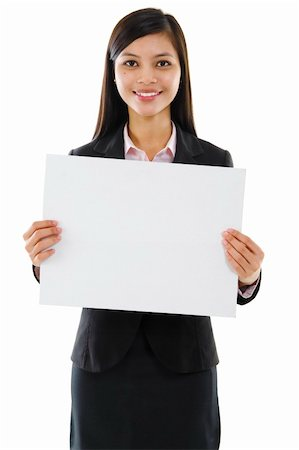 Mixed race Asian businesswoman holding a white board Stock Photo - Budget Royalty-Free & Subscription, Code: 400-06071690