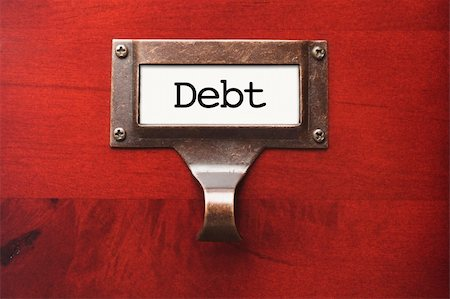 education loan - Lustrous Wooden Cabinet with Debt File Label in Dramatic LIght. Stock Photo - Budget Royalty-Free & Subscription, Code: 400-06072564