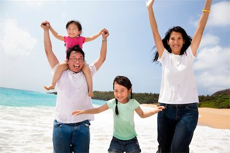 family fun day background - happy asian family jumping on the beach Stock Photo - Budget Royalty-Free & Subscription, Code: 400-06084122
