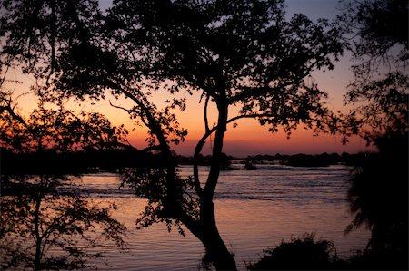 Sunset over the Zambezi River, Livingstone, Zambia Stock Photo - Budget Royalty-Free & Subscription, Code: 400-06084825