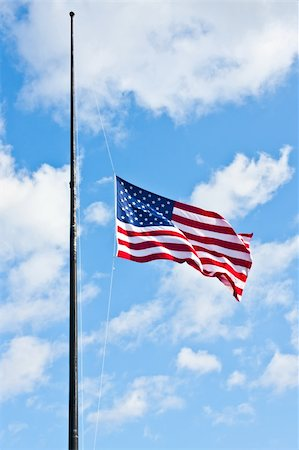 flag at half mast - American flag on a blue sky during a windy day Stock Photo - Budget Royalty-Free & Subscription, Code: 400-06086537