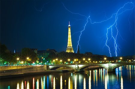 Powerful thuderbolt behind the Eiffel tower. August 2011. Paris. Stock Photo - Budget Royalty-Free & Subscription, Code: 400-06086762