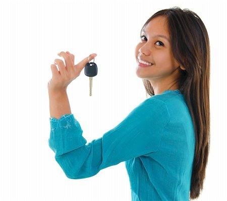 finger holding a key - Young pan asian teen holding her first car key on white background Stock Photo - Budget Royalty-Free & Subscription, Code: 400-06087232