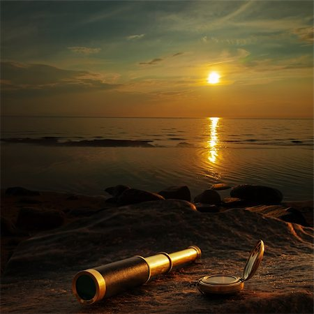scope - antique brass telescope and compass at sea coast stone Stock Photo - Budget Royalty-Free & Subscription, Code: 400-06080650