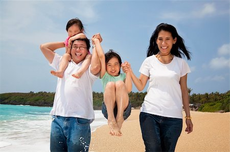 family fun day background - happy  family  on the beach Stock Photo - Budget Royalty-Free & Subscription, Code: 400-06080734